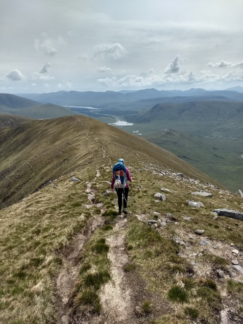 Heading down from the third and final munro
